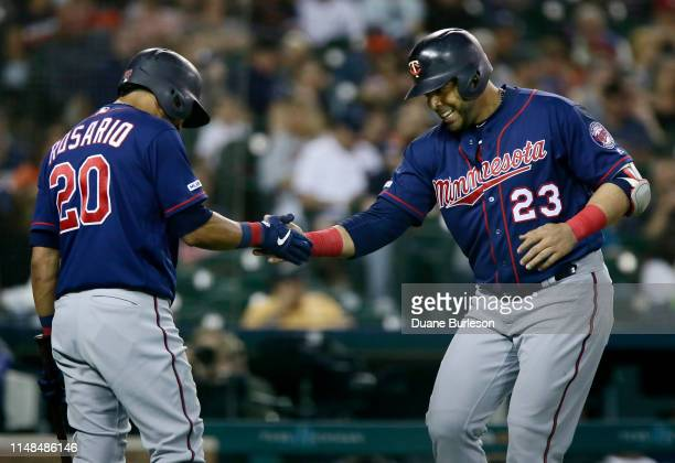 Nelson Cruz of the Minnesota Twins celebrates his solo home run that broke a 33 tie against the Detroit Tigers with Eddie Rosario of the Minnesota...