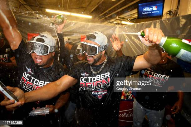 Nelson Cruz of the Minnesota Twins celebrates winning the American League Central Division title after a 51 win against the Detroit Tigers and a...