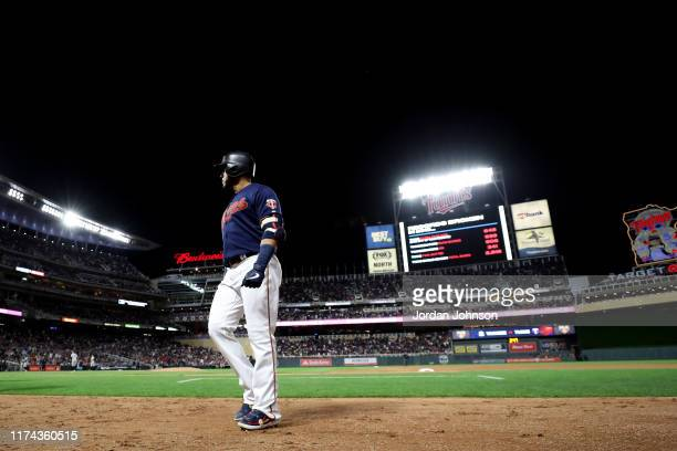 Nelson Cruz of the Minnesota Twins heads into the dugout against the New York Yankees in Game 3 of the ALDS between the New York Yankees and the...