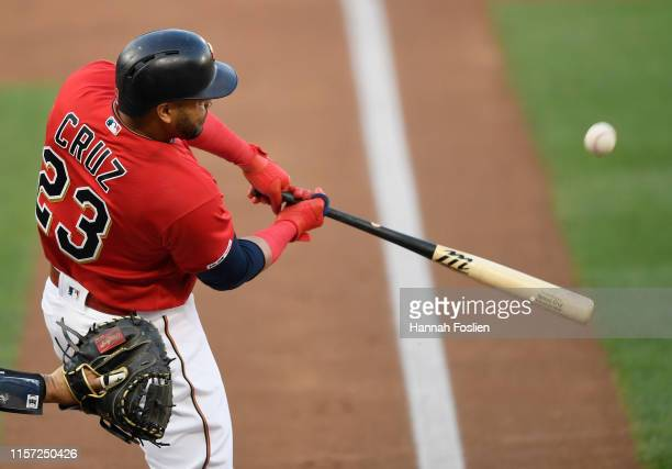 Nelson Cruz of the Minnesota Twins hits a solo home run against the New York Yankees during the first inning of the game on July 22, 2019 at Target...