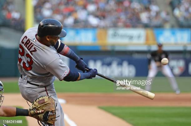 Nelson Cruz of the Minnesota Twins hits a solo home run in the 1st inning against the Chicago White Sox at Guaranteed Rate Field on July 25 2019 in...