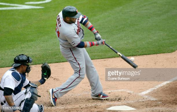 Nelson Cruz of the Minnesota Twins hits a solo home run with catcher Wilson Ramos of the Detroit Tigers behind the plate during the fifth inning at...