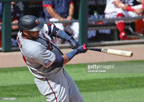Nelson Cruz of the Minnesota Twins hits a three run home run in the 8th inning against the Chicago White Sox at Guaranteed Rate Field on July 26 2020...