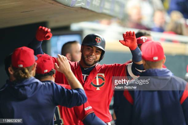 Nelson Cruz of the Minnesota Twins is all smiles after hitting a home run in the fifth inning against the Baltimore Orioles at Target Field on April...