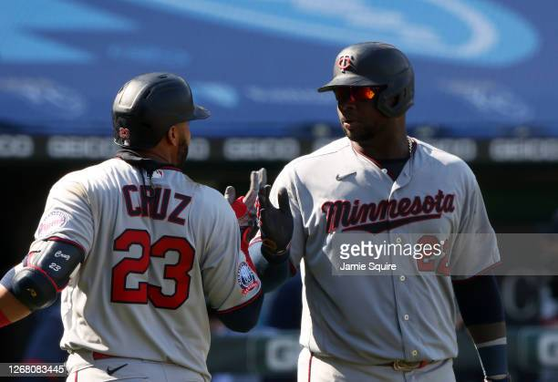 Nelson Cruz of the Minnesota Twins is congratulated by Miguel Sano after hitting a home run off Trevor Rosenthal of the Kansas City Royals during the...