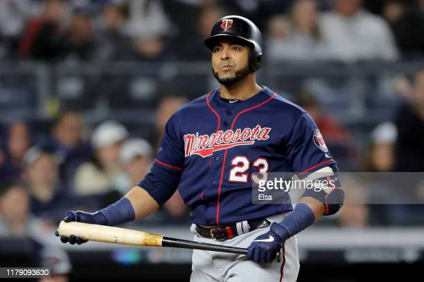 Nelson Cruz of the Minnesota Twins reacts after striking out against the New York Yankees during the seventh inning in game one of the American...