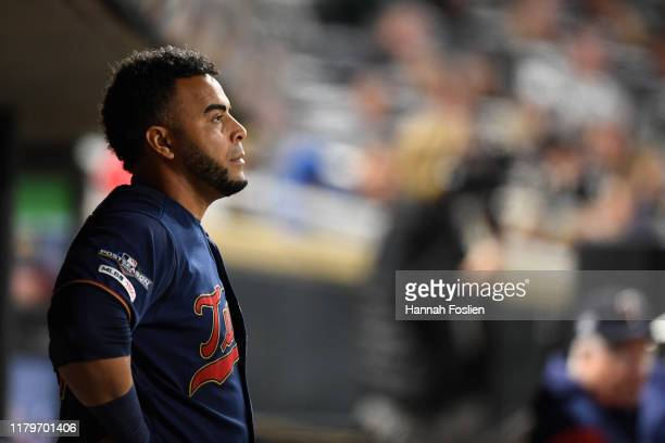 Nelson Cruz of the Minnesota Twins stands in the dugout in game three of the American League Division Series against the New York Yankees at Target...