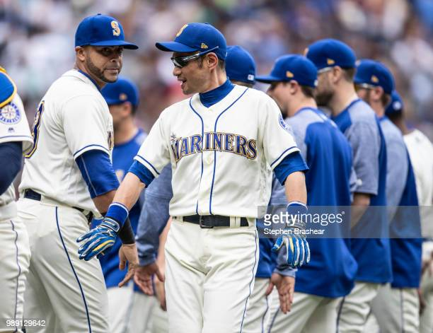 Nelson Cruz of the Seattle Mariners and Ichiro Suzuki of the Seattle Mariners celebrate after a game against the Kansas City Royalssat Safeco Field...