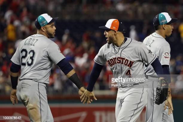 Nelson Cruz of the Seattle Mariners and the American League and George Springer of the Houston Astros and the American League celebrate after...