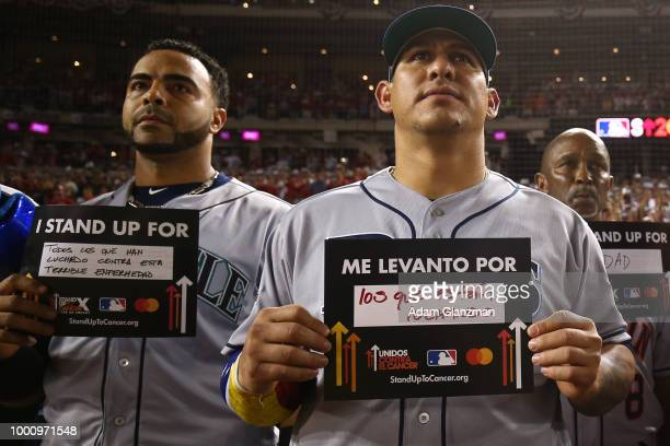 Nelson Cruz of the Seattle Mariners and Wilson Ramos of the Tampa Bay Rays hold up Stand Up to Cancer placards during the 89th MLB AllStar Game at...