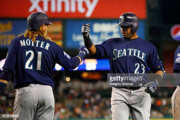Nelson Cruz of the Seattle Mariners celebrates his fifthinning tworun home run with Taylor Motter while playing the Detroit Tigers at Comerica Park...