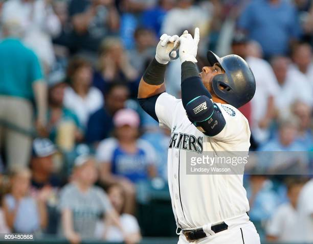 Nelson Cruz of the Seattle Mariners celebrates his solo home run in the third inning against starting pitcher Jason Vargas of the Kansas City Royals...
