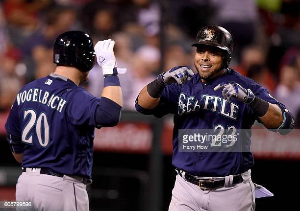 Nelson Cruz of the Seattle Mariners celebrates his solo homerun with Daniel Vogelbach of the Seattle Mariners to take a 21 lead over the Los Angeles...