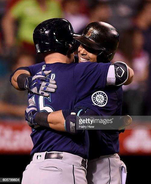 Nelson Cruz of the Seattle Mariners celebrates his solo homerun with Kyle Seager to take a 21 lead over the Los Angeles Angels of Anaheim during the...