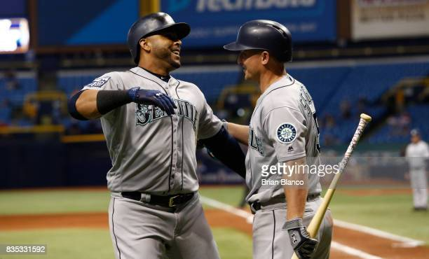 Nelson Cruz of the Seattle Mariners celebrates with teammate Kyle Seager after hitting a home run off of pitcher Brad Boxberger of the Tampa Bay Rays...