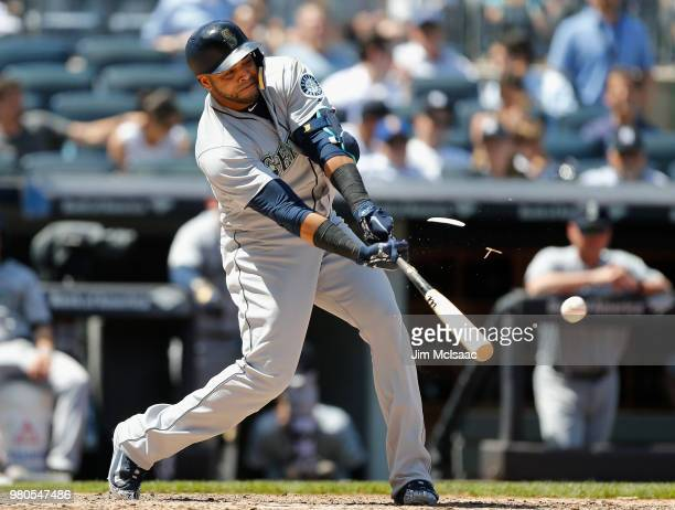 Nelson Cruz of the Seattle Mariners connects on a broken bat single in the sixth inning against the New York Yankees at Yankee Stadium on June 21...
