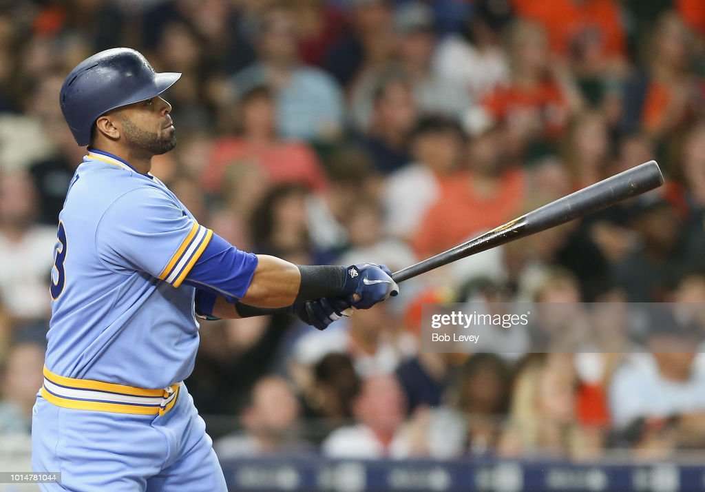 Nelson Cruz #23 of the Seattle Mariners doubles in two runs in the eighth inning against the Houston Astros at Minute Maid Park on August 10, 2018 in Houston, Texas.