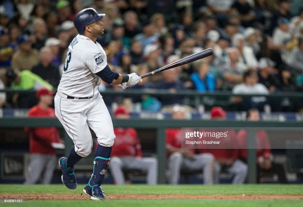 Nelson Cruz #23 of the Seattle Mariners hits a three-run home run off of relief pitcher Jesse Chavez #40 that also scored Robinson Cano #22 and Mitch Haniger #17 of the Seattle Mariners during the fourth inning of a game at Safeco Field on September 9, 2017 in Seattle, Washington.