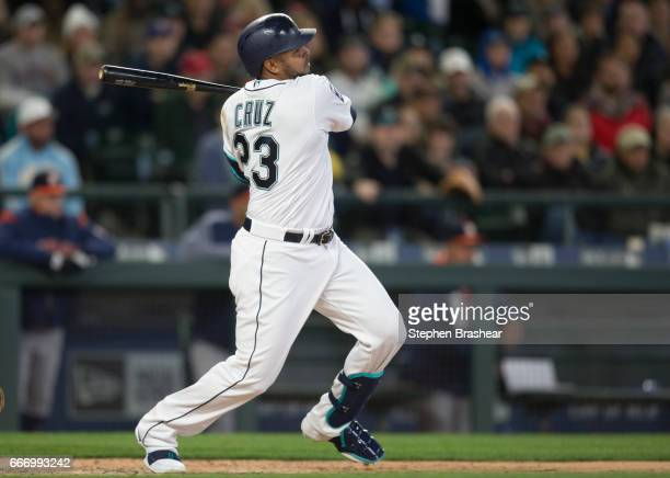 Nelson Cruz of the Seattle Mariners hits a tworun single off of starting pitcher Charlie Morton of the Houston Astros to score Taylor Motter and...