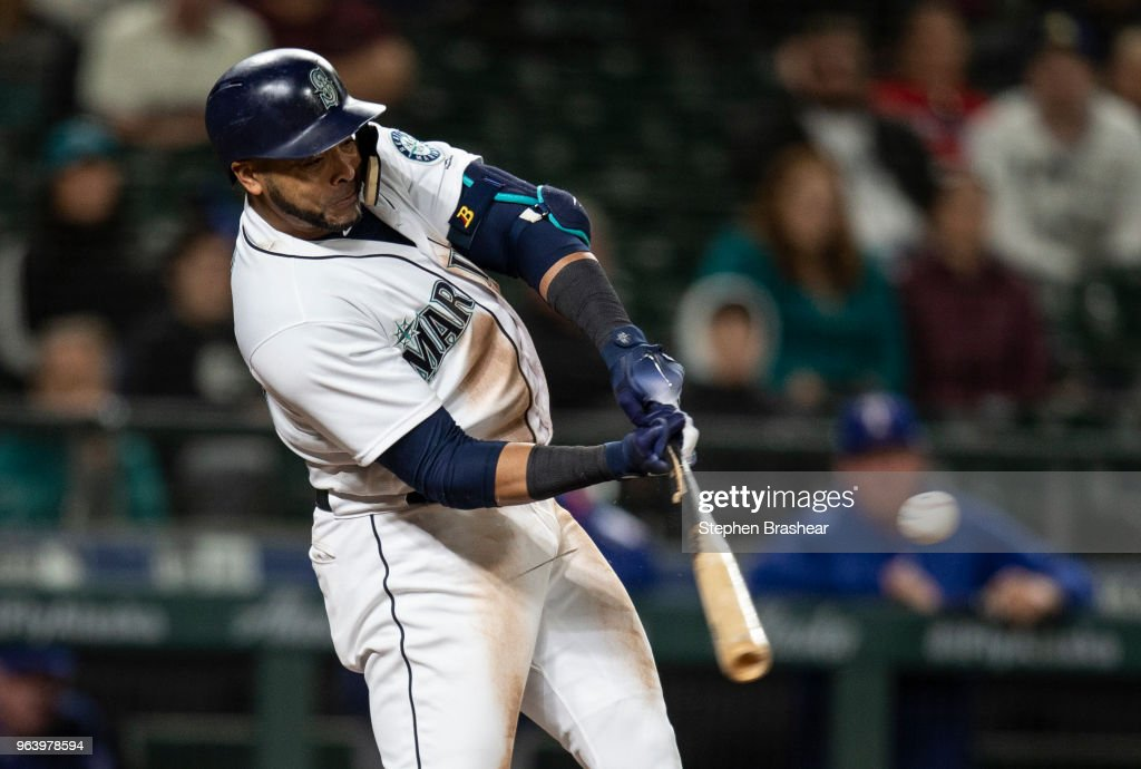 Nelson Cruz #23 of the Seattle Mariners hits an RBI-single off of relief pitcher Keone Kela #50 of the Texas Rangers to score Ben Gamel #16 of the Seattle Mariners during the ninth inning of a game at Safeco Field on May 30, 2018 in Seattle, Washington. The Rangers won 7-6.