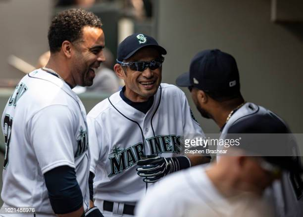 Nelson Cruz of the Seattle Mariners Ichiro Suzuki and Robinson Cano joke around in the dugout before a game against the Houston Astros at Safeco...