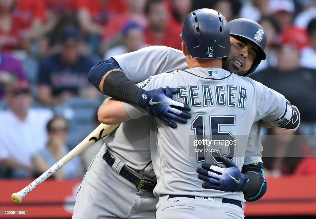 Nelson Cruz #23 of the Seattle Mariners is congratulated by Kyle Seager #15 after his fourth inning home run against the Los Angeles Angels of Anaheim at Angel Stadium on July 28, 2018 in Anaheim, California.
