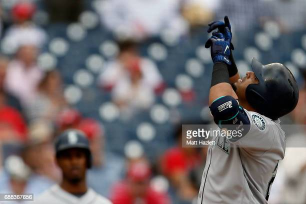 Nelson Cruz of the Seattle Mariners reacts after hitting a three run home run against the Washington Nationals during the sixth inning at Nationals...