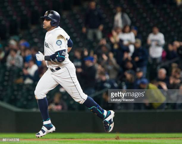 Nelson Cruz of the Seattle Mariners rounds the bases after hitting a home run in the seventh inning off of Cole Hamels of the Texas Rangers at Safeco...