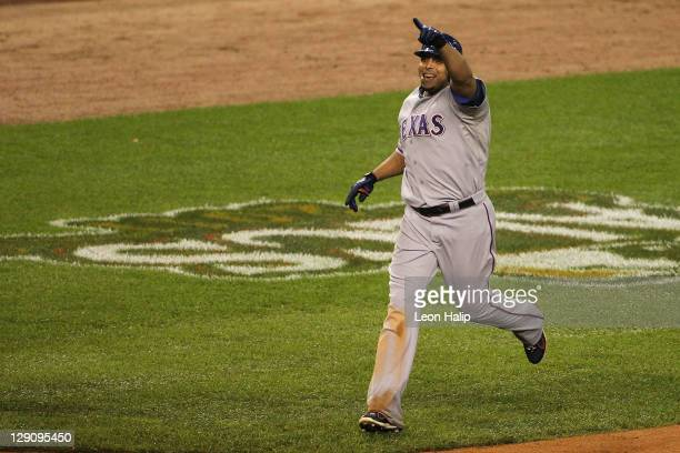 Nelson Cruz of the Texas Rangers celebrates as he runs the bases after his threerun home run in the 11th inning to take a 73 lead in Game Four of the...