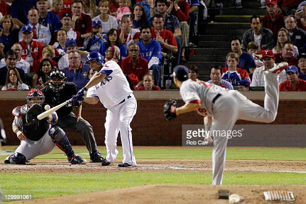 Nelson Cruz of the Texas Rangers hits a tworun home run in the fourth inning off of Kyle Lohse of the St Louis Cardinals during Game Three of the MLB...