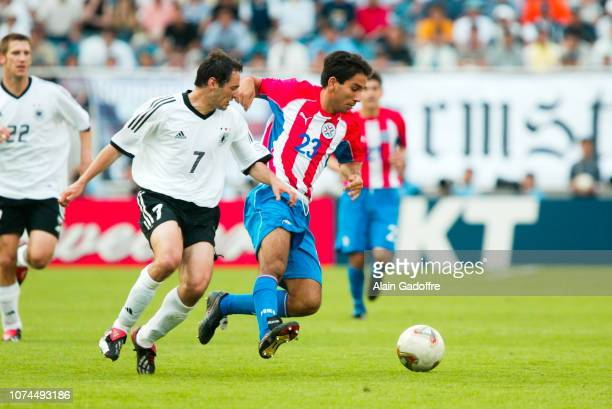 Nelson CUEVAS and Oliver NEUVILLE during the FIFA World Cup match between Germany and Paraguay on June 15 2002 in Jeju Stadium South Korea