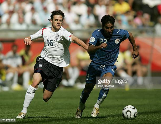 Nelson Cuevas of Paraguay is pressured by Owen Hargreaves of England during the FIFA World Cup Germany 2006 Group B match between England and...