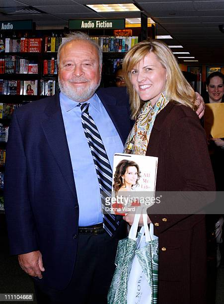 Nelson DeMille and Sandy DeMille hold copies of All My Life A Memoir at Barnes Noble 5th Avenue on March 29 2011 in New York City