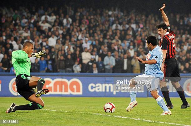Nelson Dida of AC Milan and Walter Gargano of SSC Napoli and Kakha Kaladze AC Milan in action during the Serie A match between SSC Napoli and AC...