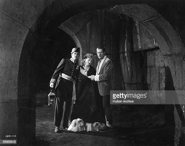 Nelson Eddy Susanna Foster and Edgar Barrier in a scene from Universal Picture's 'Phantom of the Opera'