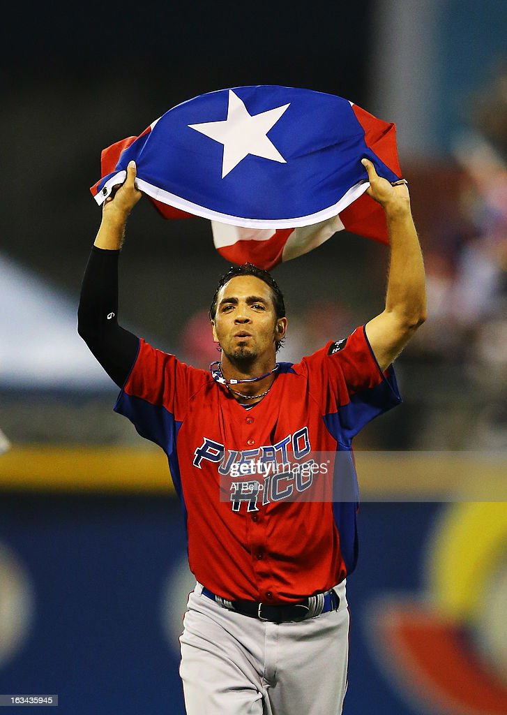 Nelson Figueroa #27 of Puerto Rico celebrates a 6-3 win against Venezuela during the first round of the World Baseball Classic at Hiram Bithorn Stadium on March 9, 2013 in San Juan, Puerto Rico.
