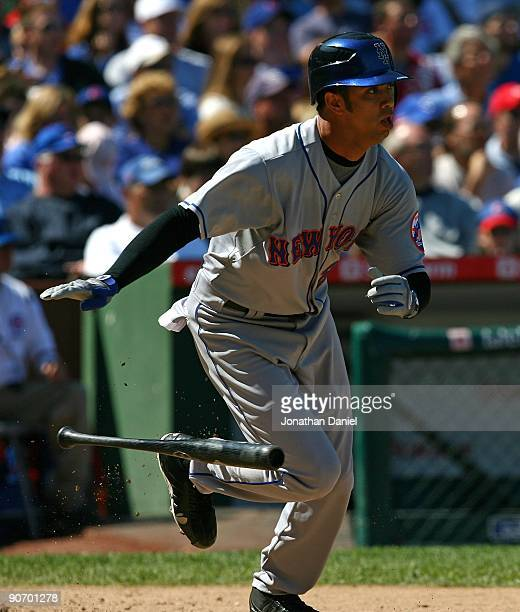 Nelson Figueroa of the New York Mets runs to first base after hitting against the Chicago Cubs on August 30 2009 at Wrigley Field in Chicago Illinois...