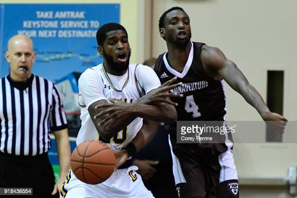 Nelson Kaputo of the St Bonaventure Bonnies bats the ball from BJ Johnson of the La Salle Explorers during the first half at Tom Gola Arena on...