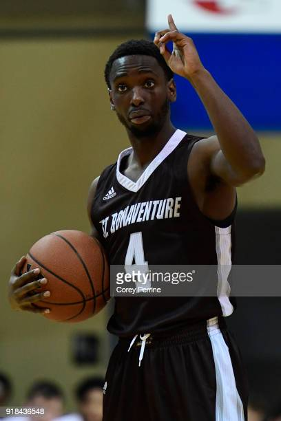 Nelson Kaputo of the St Bonaventure Bonnies talks to his team before running a play against the La Salle Explorers during the first half at Tom Gola...