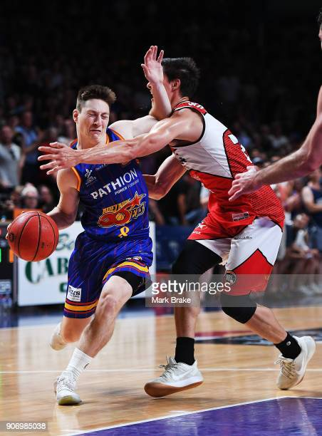 Nelson Larkins of the Adelaide 36ers is fouled by Indiana Faithfull of the Illawarra Hawks during the round 15 NBL match between the Adelaide 36ers...