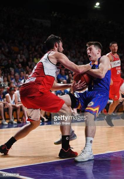 Nelson Larkins of the Adelaide 36ers is fouled by Kevin White of the Illawarra Hawks during the round 15 NBL match between the Adelaide 36ers and the...