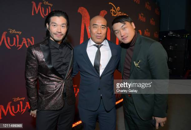 Nelson Lee Ron Yuan and Doua Moua attend the World Premiere of Disney's 'MULAN' at the Dolby Theatre on March 09 2020 in Hollywood California