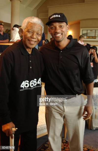 """Nelson Mandela and actor Will Smith participate in, """"46664 Celebrity Golf Tournament,"""" following yesterday's charity concert, """"46664 South Africa,""""..."""