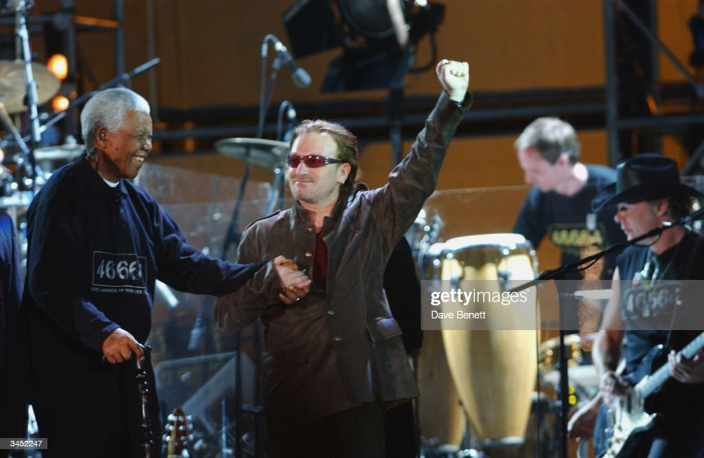 Nelson Mandela and Bono of U2 perform at The Nelson Mandela Foundation's '46664 Give One minute to Aids' Concert at The Greenpoint Stadium on November 29, 2003 in Cape Town.