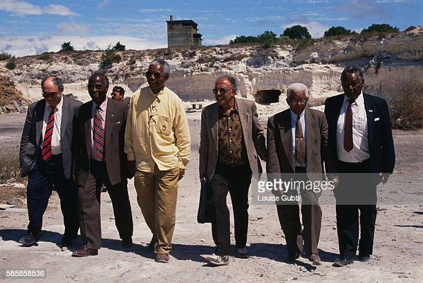 Nelson Mandela and fellow imprisoned Rivonia trial convicts including Ahmed Kathrada who can be seen to the right of Mandela revisit the lime quarry...