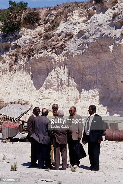 Nelson Mandela and fellow imprisoned Rivonia trial convicts revisit the lime quarry where the Robben Island prisoners worked President of South...