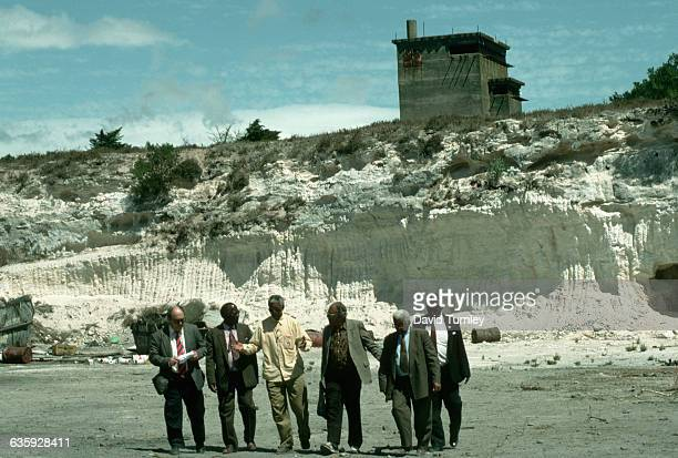 Nelson Mandela and fellow political prisoners at a lime quarry where they had been forced to do hard labor on Robben Island off the coast of the...