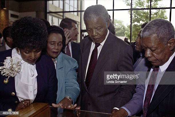 Nelson Mandela and his former wife Winnie Mandela tour the Martin Luther King Center in Atlanta. With him are Coretta Scott King and Insurance...