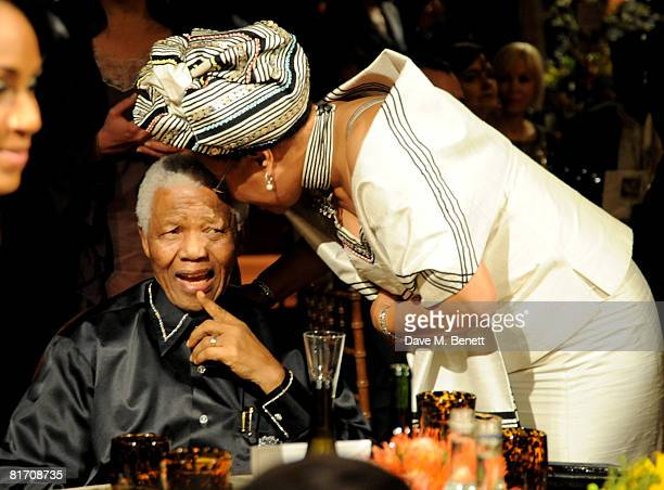 Nelson Mandela and his wife Graca Machel attend the dinner in honour of Nelson Mandela celebrating his 90th birthday at Hyde Park on June 25 2008 in...