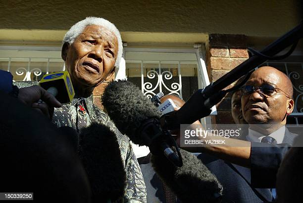 Nelson Mandela and Jacob Zuma South Africa's Deputy President arrive 06 May 2003 at Walter Sisulu's house in Linden to pay tribute to the veteran...
